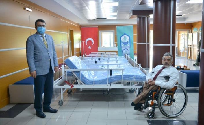 Çok fonksiyonlu engelli yatağı ihtiyaç sahiplerine dağıtıldı